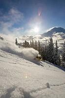 A skier in deep sunset powder in Washington.