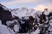 Skiers enjoying the sunrise on Mt. Sneffels, 14,150ft. San Juan Mountains, Colorado.