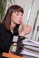 female smoking in office