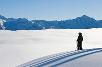 Man traversing on skis, BC, Canada.