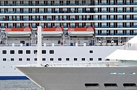 Two cruise ships sail past each other tight, details