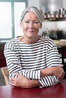 Germany, Wakendorf, Senior woman smiling, portarit