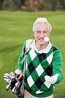 Italy, Kastelruth, Mature man playing with golf ball