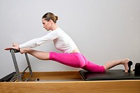 gym woman pilates stretching sport in reformer bed instructor girl