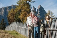 Italy, South Tyrol, Mature couple hiking on dolomites