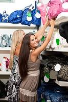 Beautiful young women inside a bags shop