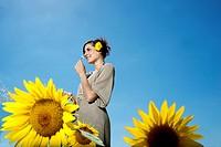 Woman in sunflower field