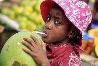 enfant buvant du jus de coco Ile de la Martinique Departement et Region d´Outremer francais Archipel des Antilles Caraibes//kid drinking coconut water...