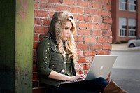 Female student with a laptop studying