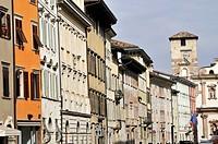 Historical buildings follow along main street of Trento, Trentino, Italy.