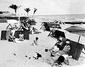 People relaxing at the shore in Palm Beach, Florida. 1/20/33. Courtesy: CSU Archives/Everett Collection.