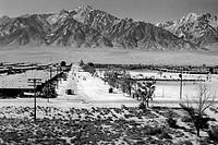 World War II, Bird´s_eye view of Manzanar Relocation Center, showing buildings, roads, and Sierra Nevada mountains in background. California. photogra...