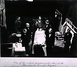 Fully dressed female patient lying on the operating table, surrounded by the surgeons of Massachusetts General Hospital in one of the earliest operati...