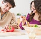 Couple preparing salad together