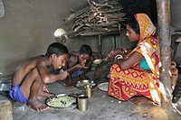 Mayna Das, wife of a palanquin porter looks to her child as they have their lunch Palanquins are still used for carrying brides in remote Bangladesh I...