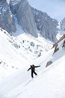 A boy snowboarding in the California backcountry.