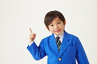 Well Dressed Smiling Boy Pointing
