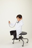 Boy as Doctor Sit on Chair with Stethoscope