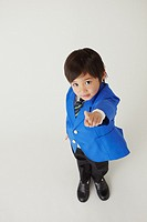 Well Dressed Boy Pointing