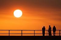 People watching sunset on pier- Jekyll Island, Georgia
