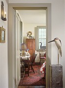COLLECTION DISPLAYS _ Wood carved water fowls and geese on display in hallway and family room. Early American antiques. Red area rug.