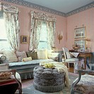 LIVING ROOM _ Pretty Living Room. Sofa, hassock, French style, pastels, mixed patterns, triple swag valences, floral curtains, pastel wallpaper and bo...