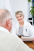 Doctor and patient talking in clinic