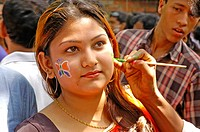 A young lady gets her face painted welcoming the Bangla New Year 1413, or Pohela Baishakh, a festival rooted deep in the cultural tradition of the nat...