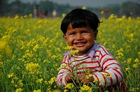 A smiling child in the midst of a mustard field Hasempur, Jessore, Bangladesh January 4, 2008