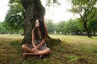Pure, natural, beautiful young woman in nature, sitting under a tree  Taken in Lipica, Slovenia  Concept: teenagers and nature