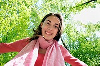 Smiling young woman in woods