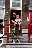 Man holding girl outside hotel door