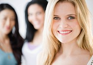 Smiling Caucasian woman standing with friends