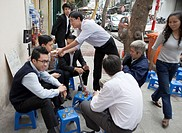 Group of Men having Tea on a Hanoi Sidewalk, Vietnam