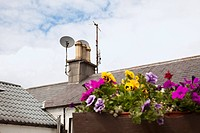 chimney and satellite dish on a roof, avoca, county wicklow, ireland