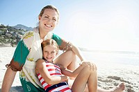 Portrait of mother and daughter 10_12 sitting on beach