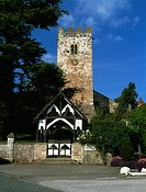 Wales, Denbighshire, Bodfari. The Perpendicular tower and timber_framed lychgate of St Stephen´s Church.