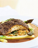 Sea bream on beans and asparagus