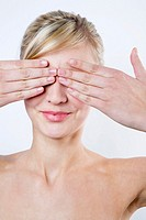 Blond Woman Covering Her Eyes With Her Hands