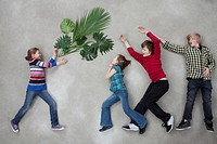 Children with plant and showing ecology symbol