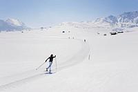 Italy, Trentino_Alto Adige, Alto Adige, Bolzano, Seiser Alm, Mid adult woman doing cross_country skiing