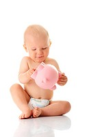 Young baby boy playing with pink piggy bank