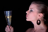 Beautiful blonde with a champagne glass.