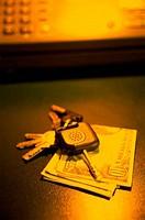 Close_up of keys on paper money