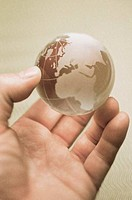 Person´s hand holding a globe