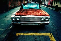 Rusty 1963 Chevrolet Impala on the street in New Orleans, Louisiana.