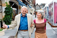 Mature couple walking in a shopping district