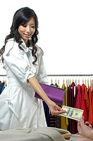 Woman paying in a clothing store
