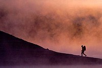 Silhouette of a man hiking near a lake, Truckee, California, USA