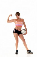 Woman with soccer ball showing muscles
